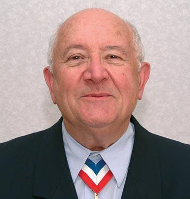 Pierre Pignat, président honoraire et commissaire adjoint